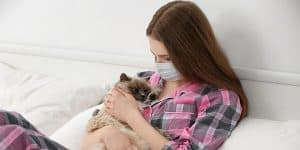 woman allergic to cat has to wear mask just to pet it