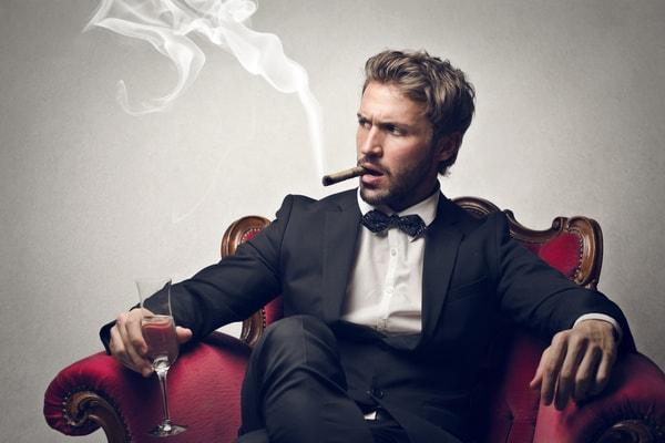 cigar smoking man in chair